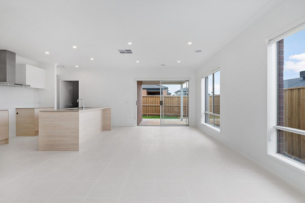 Generous family living kitchen area with walk-in pantry and walk-in linen cupboard.